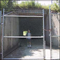 the view through the gate that blocks the tunnel under I-89