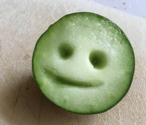 little smiling face carved from a cucumber