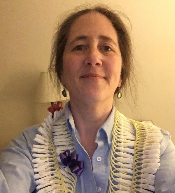 me wearing two separate leis