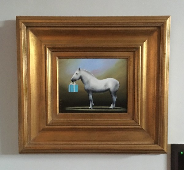 image of an odd painting heere a hors eis standing in profile holding a tiffany colored box in its mouth