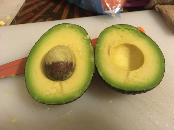 one perfect avocado, cut in half