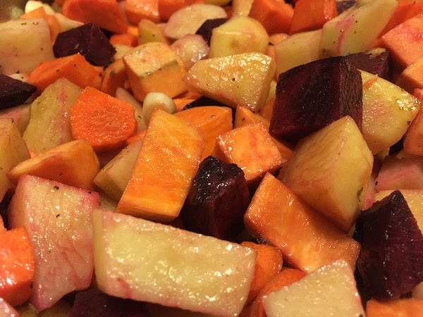 close up of a tray of roasted veggies in oranges and reds and beiges
