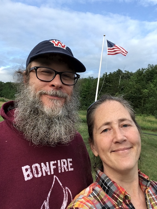 Me and Jim, outside, standing in front of an American flag